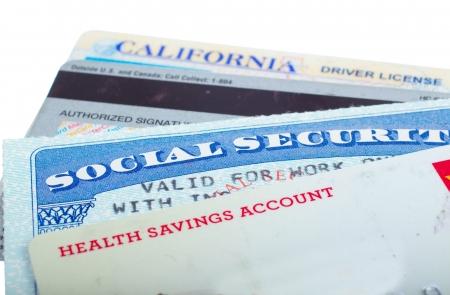 白で隔離社会保障とドライバーのライセンス カード 写真素材