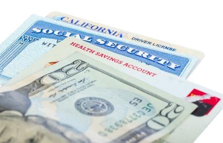 社会保障とドライバーのライセンス カードを白で隔離されます。 写真素材