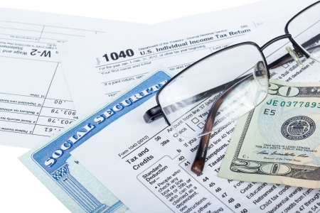 American federal tax form 1040 with money and social security card isolated on white  Standard-Bild