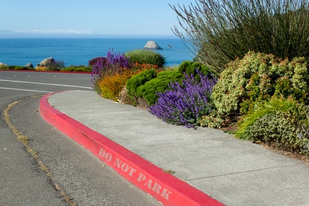 Red curb with no parking sign, fire lane Stock Photo - 20705493