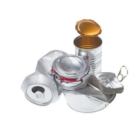 crushed aluminum cans: Recyclable garbage isolated on white background.