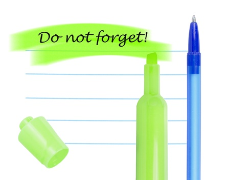 Memo note with highlighter and pen isolated on white background. photo
