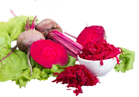Red beets root and greens isolated on white background.