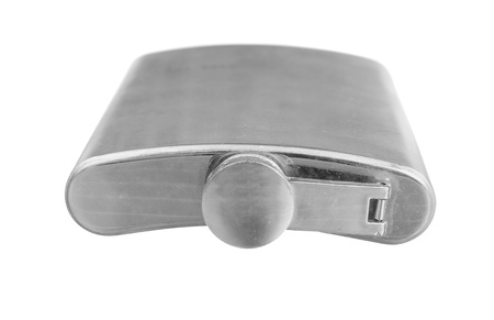 tilted view: Stainless steel pocket hip flask isolated on white background Stock Photo