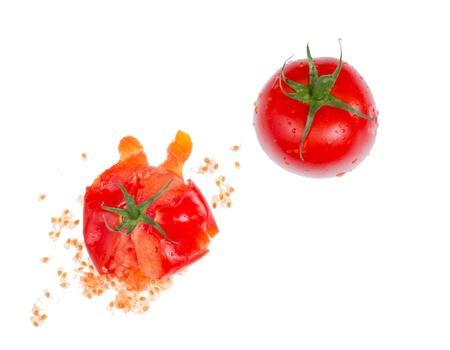 Crushed fresh tomato isolated on white background.