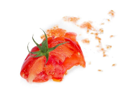 Crushed fresh tomato isolated on white background.