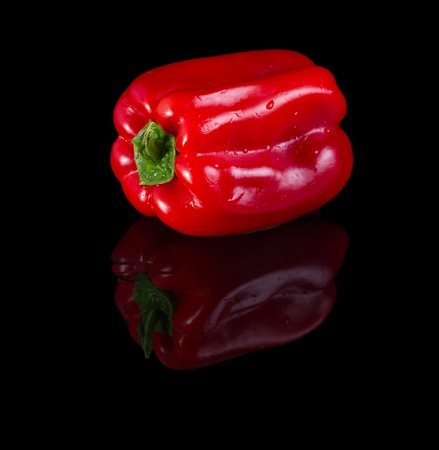 Red bell pepperisolated on black background with reflection.  Stock Photo - 21949340