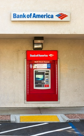 SACRAMENTO, USA - SEPTEMBER 5: Bank of America ATM machine on September 5, 2013 in Sacramento, California. The Bank of America Corporation is an American multinational banking and financial services corporation pronounced the second largest bank holding c Редакционное