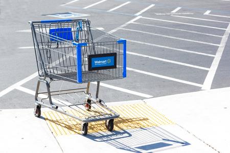 SACRAMENTO, USA - SEPTEMBER 13: Walmart shopping cart on September 13, 2013 in Sacramento, California. Walmart is an American multinational retail corporation that runs chains of large discount department stores