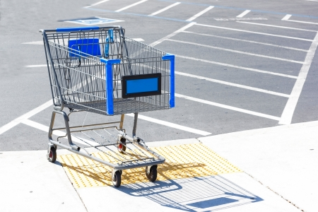 Shopping cart on empty parking lot.