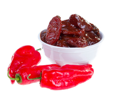 Red jalapeno peppers and chipotles (smoke-dried pods) in adobo sauce isolated on white background.