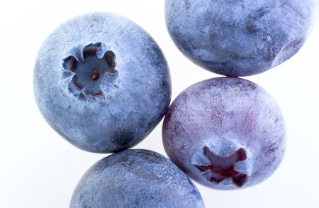 Extreme closeup of blueberry on white background.