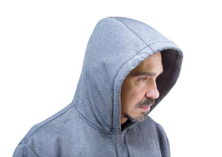 Hoofd schot van volwassen Kaukasische man in Hooded Sweatshirt geïsoleerd op een witte achtergrond. Stockfoto
