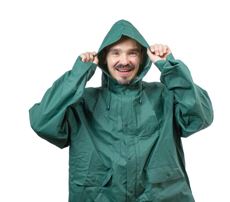 protective: Caucasian man in a rain suit putting the hood over the head isolated on white background.