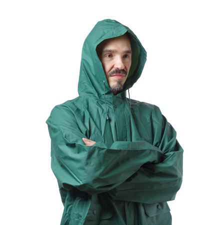 protective: Caucasian man in hooded rain suit isolated on white background. Stock Photo