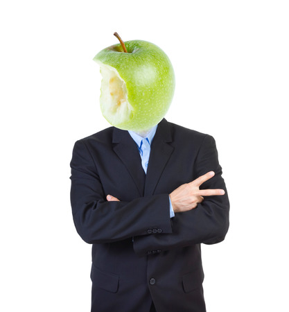 indoctrinate: Man in a business suit with eaten apple replacing his head isolated on white .