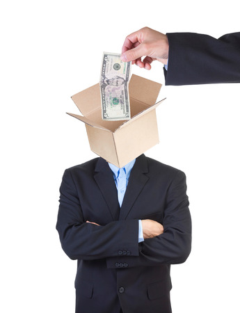 indoctrinate: Hand putting money into mans head represented by open cardbox isolated on white.