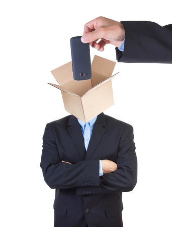 indoctrinate: Hand putting cell phone into mans head represented as an open empty cardbox isolated on white . Stock Photo