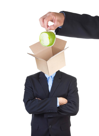 indoctrinate: Hand putting eaten apple into mans head represented as an open empty cardbox isolated on white .