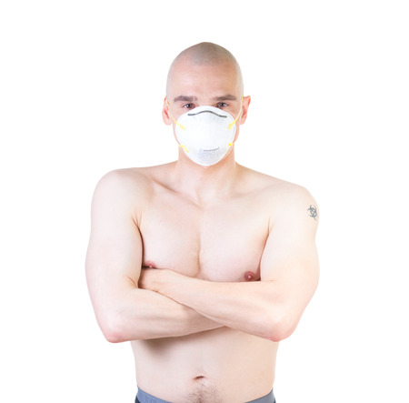 dust mask: adult man in respirator mask isolated on white .