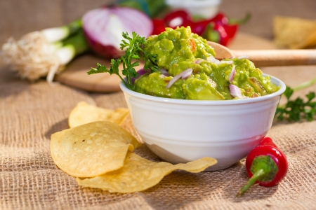 Southwest guacamole served with corn chips and pepper.