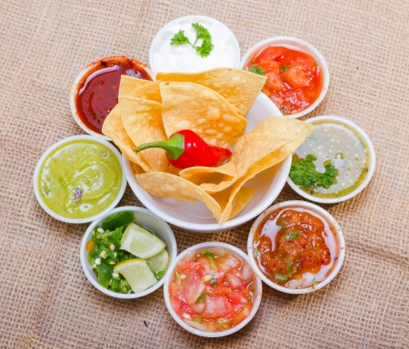 Corn chips served with assorted salsas.