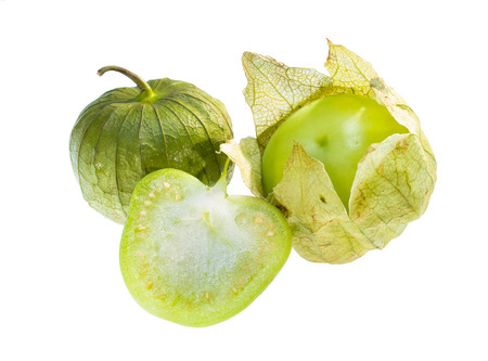 Center cut, peeled and whole tomatillo isolated on white background.