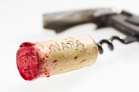Cork from Napa valley stained with red wine. To editor: Napa Valley is the name of geographic area with developed wine industry in the US. This is not a brand name.