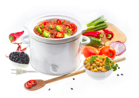 Pinto and garbanzo beans cooked in slow cooker with vegetables. Stock Photo