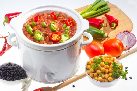 cookers: Pinto and garbanzo beans cooked in slow cooker with vegetables. Stock Photo