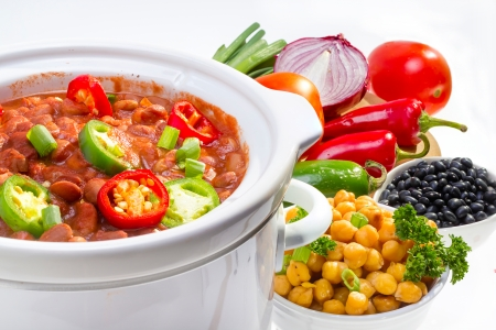 cooker: Pinto and garbanzo beans cooked in slow cooker with vegetables. Stock Photo