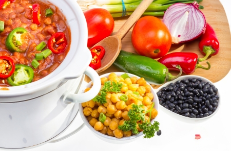 pinto beans: Pinto and garbanzo beans cooked in slow cooker with vegetables. Stock Photo