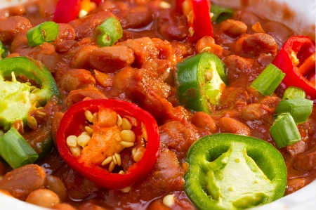 Cooked pinto beans with jalapeno peppers and green onion.