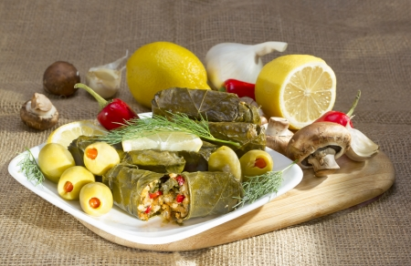 Mediterranean meal plate - grape leaves stuffed with rice. photo