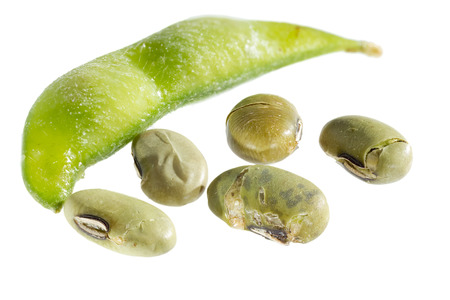 Salted and dried edamame snack on white background.