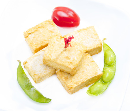 baked beans: Fried tofu served with soy bean and tomato. Stock Photo