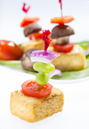 bean curd: Fried tofu canape on white background .