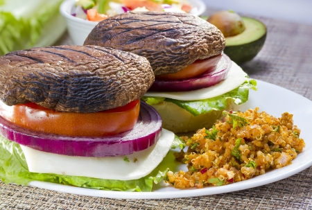 Grilled portabella vegetarian burger served with vegetables. photo