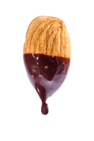 liquid chocolate: Almond nut dipped in liquid chocolate isolated on white background. Stock Photo