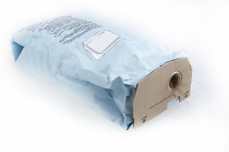 Used full vacuum cleaner disposable bag with dirt sticking out .