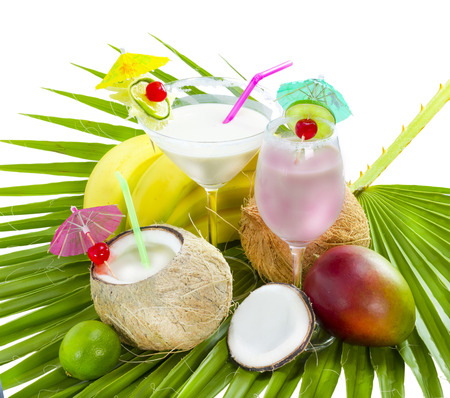 Tropical cocktail with coconut milk served on palm leaf.