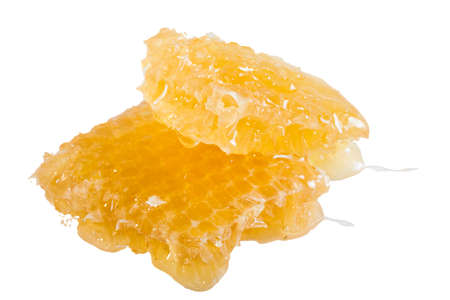 Cut fresh honeycomb isolated on white background .