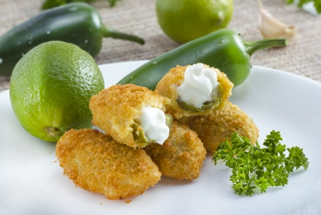Mexican-american jalapeno poppers served with lime . 写真素材