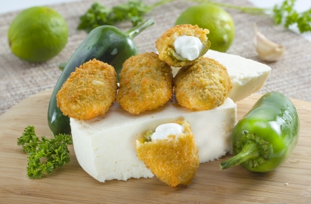 poppers: Mexican-american jalapeno poppers served with lime . Stock Photo