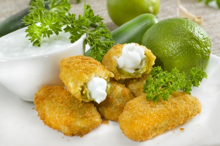 Mexican-american jalapeno poppers served with lime . 版權商用圖片