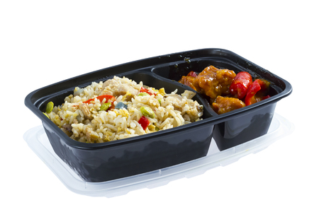 Chicken rice and sour pork in black plastic lunch box 写真素材