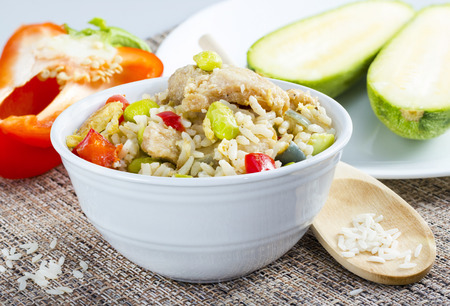 Chicken rice with green beans and vegetables served in a bowl Stock Photo