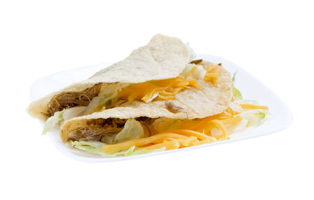 Pulled pork (carne asada) hard shell tacos isolated on white background