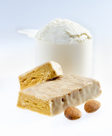 Protein bar and scoop of protein powder.