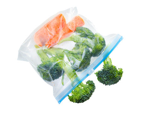 Vegetables in clear plastic bag isolated on white background . Standard-Bild